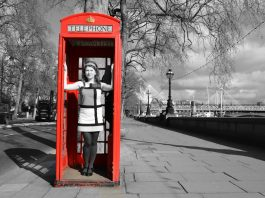 Girl in red phone box